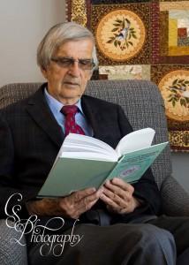 John B Toews Portrait reading book